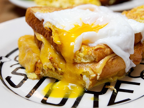 poached egg-filled, double-decker French toast grilled cheese sandwich ...