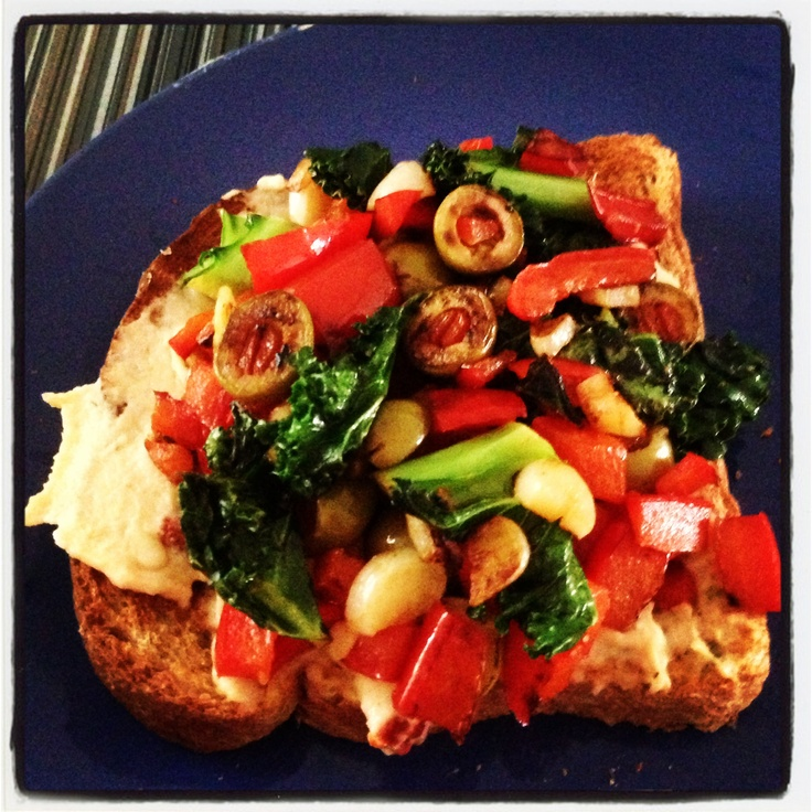 toast topped with Mediterranean hummus, pine nuts and sautéed kale ...