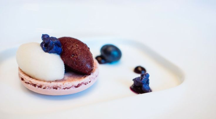 Blueberry and lychee sorbet atop macarons with sugar coated violets ...