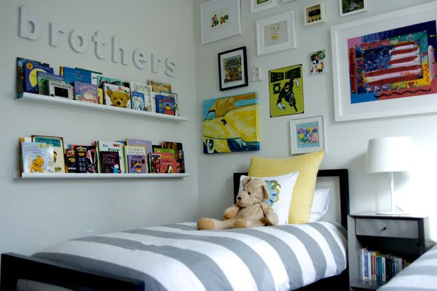 We love the reading wall (pictures ledges from @Room & Board ) in this shared #bigboyroom!