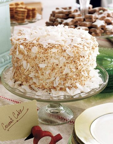 Layers of rum syrup are hidden within this toasted coconut cake.
