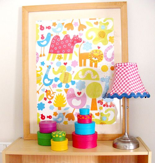 Wrapping paper nursery wall art - pick something fun and whimsical or go totally modern! #DIY #wallart
