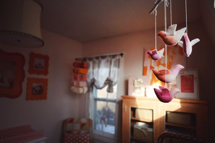 Precious pink, orange and coral bird mobile from @Etsy! #nursery #mobile