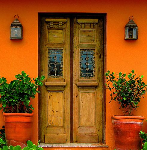 Orange with wooden door.