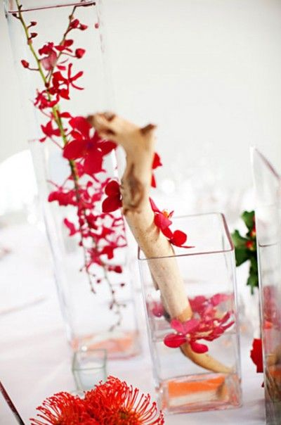 Modern red branch centerpiece submerged flowers