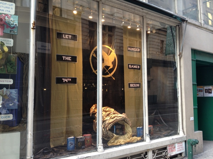 """Happy Hunger Games! And may the odds be ever in your favor."" Window display @booksofwonder"