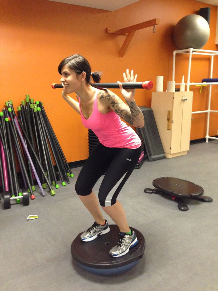Me doing squats with a weighted bar on a half bosu ball! Great for the ...