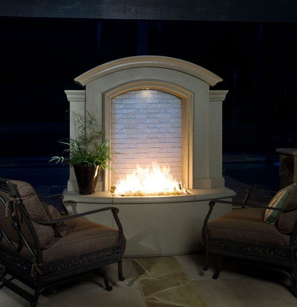 Whaat a waterfall fireplace combo outdoor spaces for Fire pit water feature combo