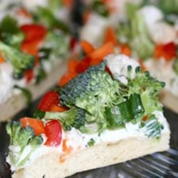 Vegetable Pizza - I have always loved this recipe.  I do not add the shredded cheese and always use reduced fat crescent rolls and cream cheese.  I topped mine with broccoli, cauliflower, red peppers, and cucumbers.