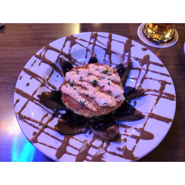 Portobello crab cake with aioli sauce and basalmic vinaigrette over ...