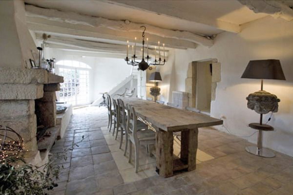 Custom made farm style table in a restored abandoned village house in Provence, France.