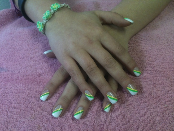 Gel nails to match a special bracelet @ A Touch of Heaven Salon and