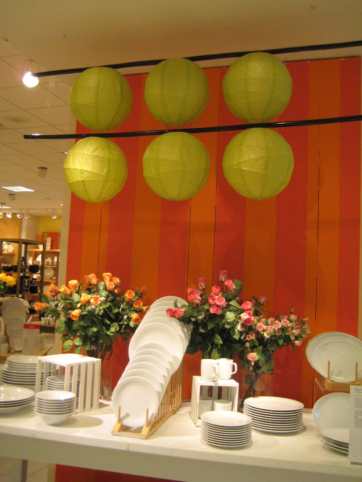 Feel like you've seen all applications of paper lanterns at an event? How about this more structured and less whimsical installation above a wedding head table or over a dance floor.  Lime, orange, and pink make a daring statement.