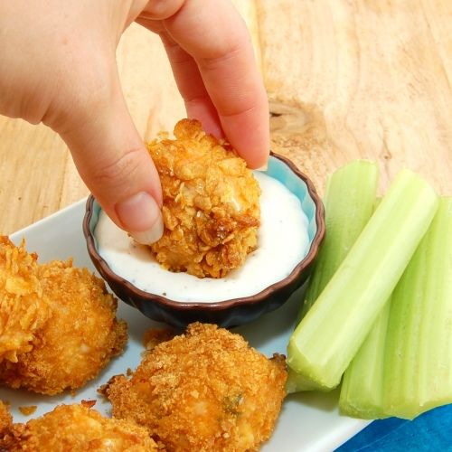 Baked Buffalo Chicken Bites by sweetpeaskitchen: A healthier version of 'wings'. #Chicken #Snacks #Buffalo_Chicken_Bites #sweetpeaskitchen