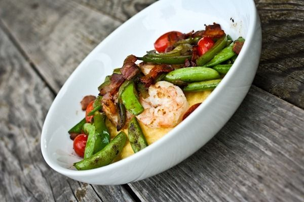 shrimp and grits with bacon, snap peas, tomatoes, and bell pepper