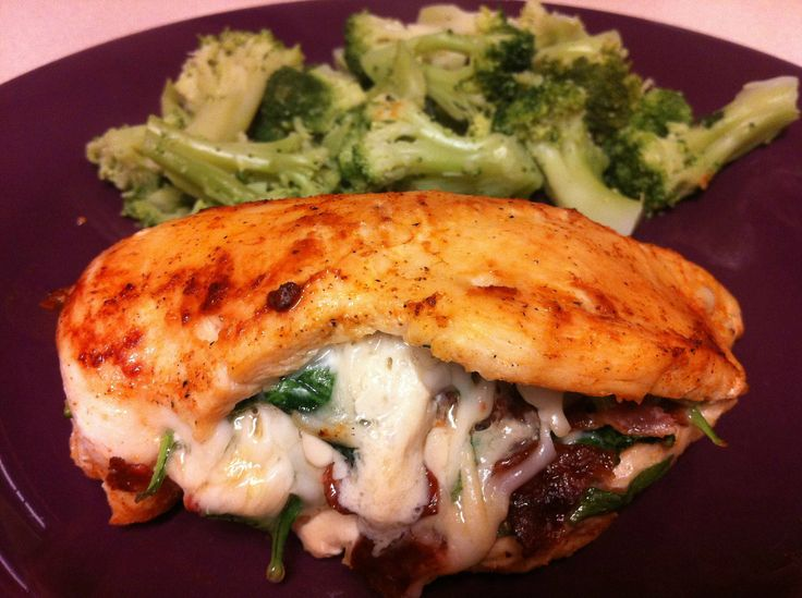 Chicken breast stuffed with bacon, baby spinach and cheese. Yum -O!!