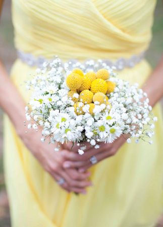 Delightful spring bridesmaid bouquet. Baby's Breath, Aster and Craspedia (Billy Balls). Creative, fun and affordable combination.