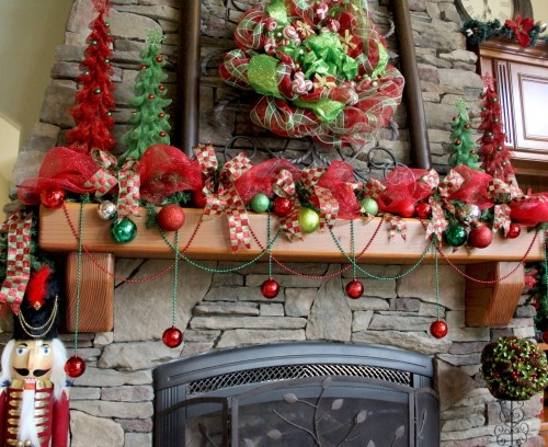 deco mesh ideas for the fireplace mantle with a wreath, garland and trees