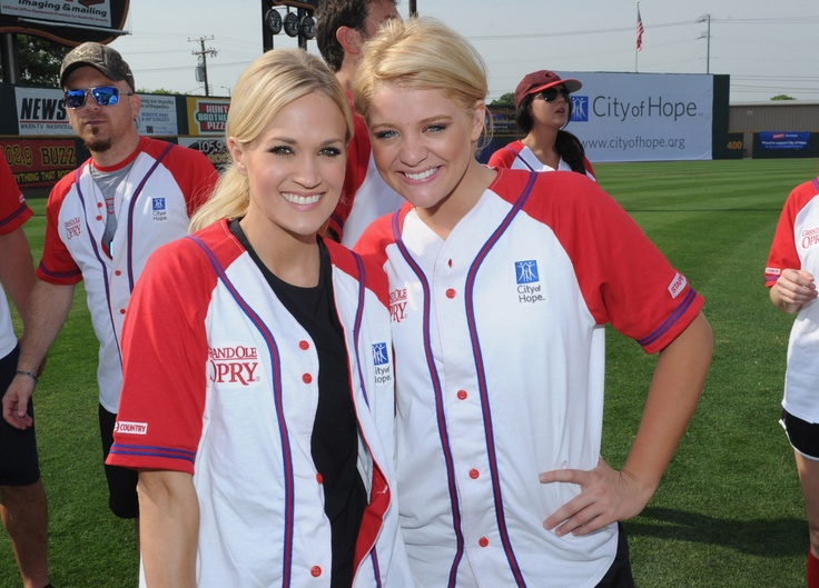 Carrie Underwood & Lauren Alaina, NASHVILLE, TN - JUNE 09: (L-R) Country artists Carrie Underwood and Lauren Alaina attend City of Hope's 22nd annual Celebrity Softball Challenge during CMA Fest on June 9, 2012 in Nashville . (Photo by Rick Diamond/Getty Images for City of Hope) , 2012