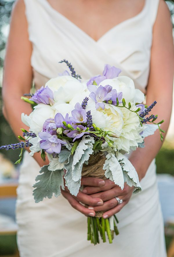 purple and white wedding bouquet #ecofriendlywedding #purplewedding #weddingchicks http://www.weddingchicks.com/2014/01/10/lavender-and-white-wedding/