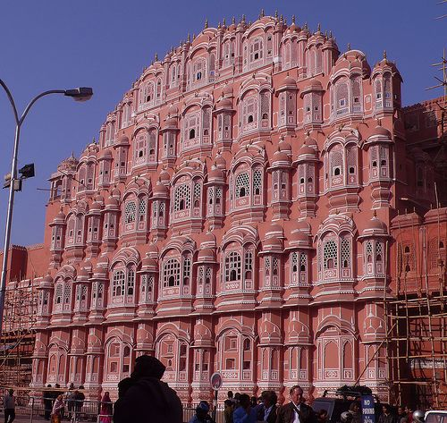 Hawa Mahal Palace ( Palace of winds) / Pink palace ... in the Pink city Jaipur.... It has 953 small windows for air circulation which makes it look like a giant honeycomb. It has a pyramid shaped facade and is made of red & pink sand stone.  By suz kosh, via Flickr
