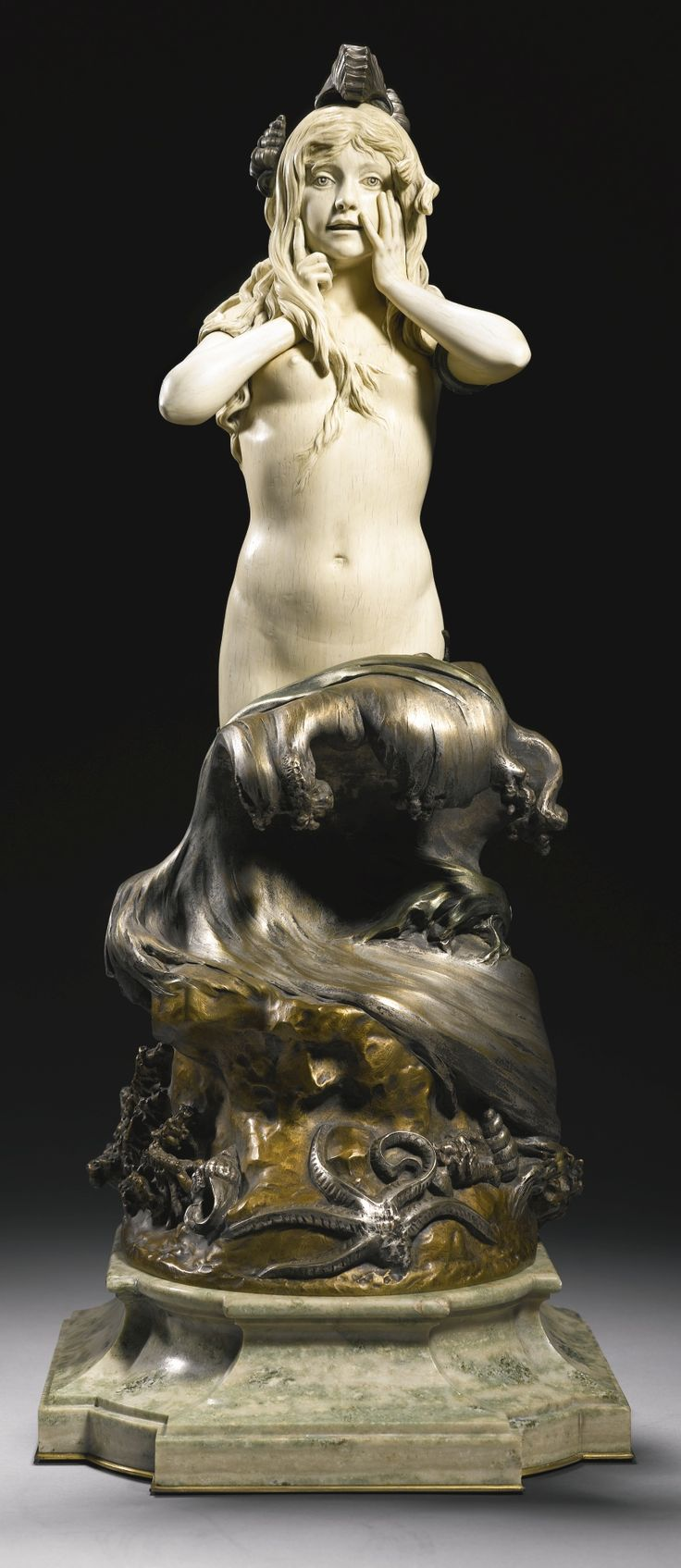 Walter Winans -  AMERICAN 1852-1920 -  THE MERMAID -  silvered and gilt bronze, and ivory, on a veined light green marble base -   signed and dated: Walter Winans 1905