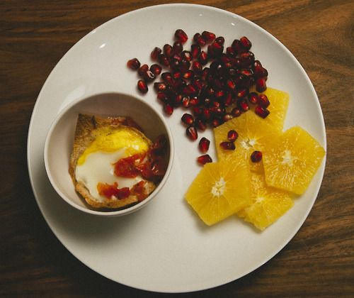 ... with garlic roasted tomatoes, orange slices, and pomegranate seeds