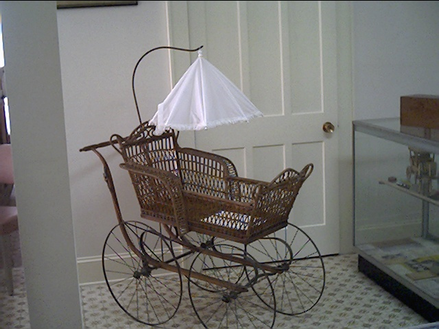 Wicker baby carriage owned by the Rich family in the late 19th. Century.