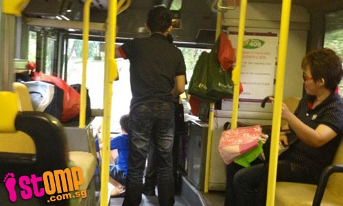 Teens sit on steps and disturb driver on SBS bus