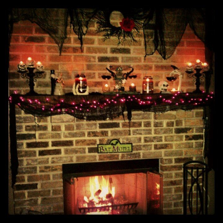 Fireplace halloween decor happy halloween pinterest for How to decorate your fireplace for halloween