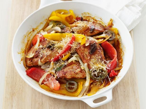 After searing pork tenderloin, finish it off with peppers and onions in a tomoto-wine sauce so it absorbs those bold flavors. #FNMag  #RecipeOfTheDay