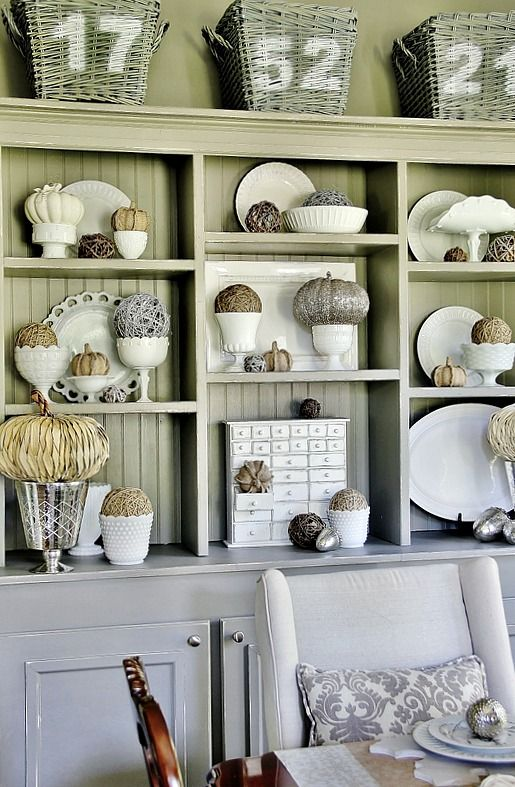 Combine textures and colors~Add a straw pumpkin to a mercury glass vase, a ball of yarn to milk glass or tuck a burlap pumpkin inside of a drawer.