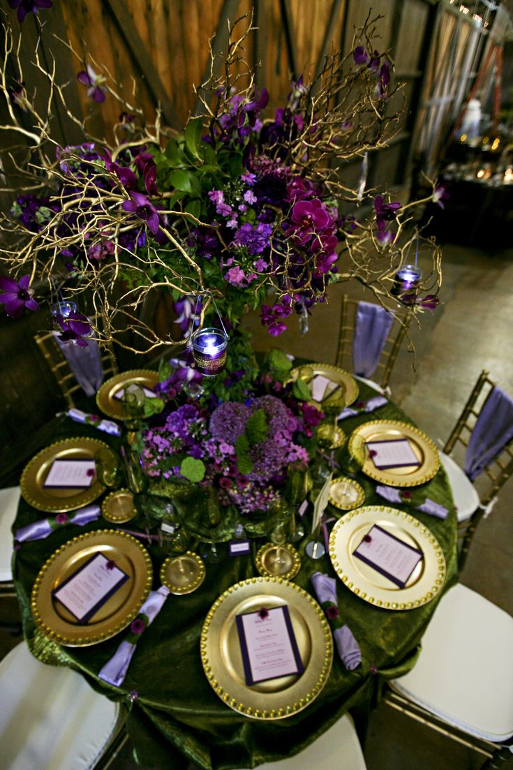 purple floral decoration with gold twigs