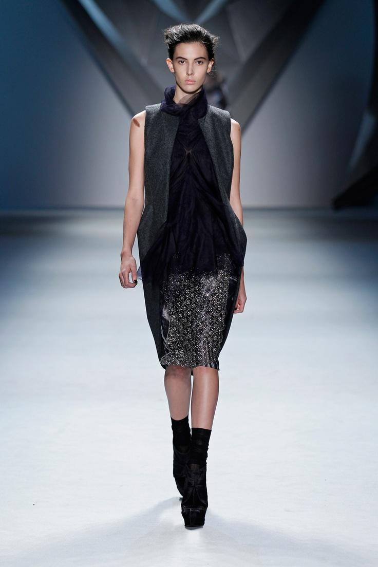 Charcoal melton cutaway high-low vest over plum silk chiffon multi-layer silk tulle flange top with black vault print silk chiffon skirt and crystal mesh overlay.