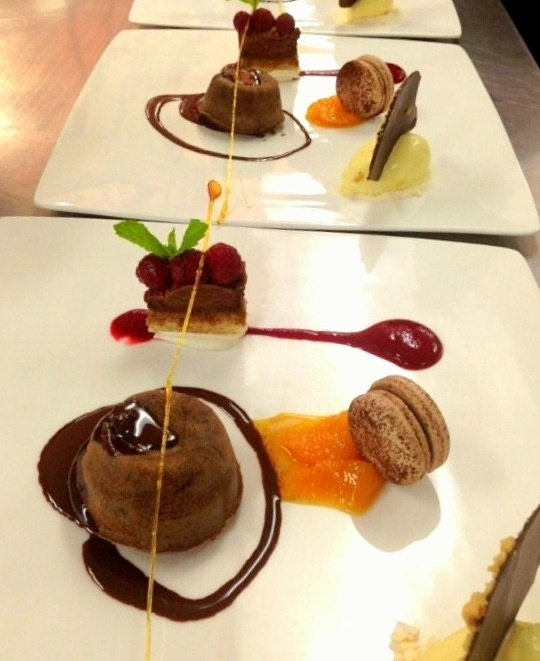 chocolate mousse with raspberry coulis topped with fresh raspberries ...