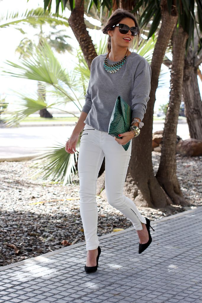 white jeans + emerald clutch + grey sweatshirt + black pumps + emerald ombre statement necklace