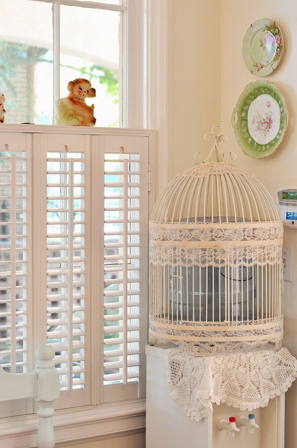Birdcage used to cover water dispenser. Neat idea. Shabby chic style.