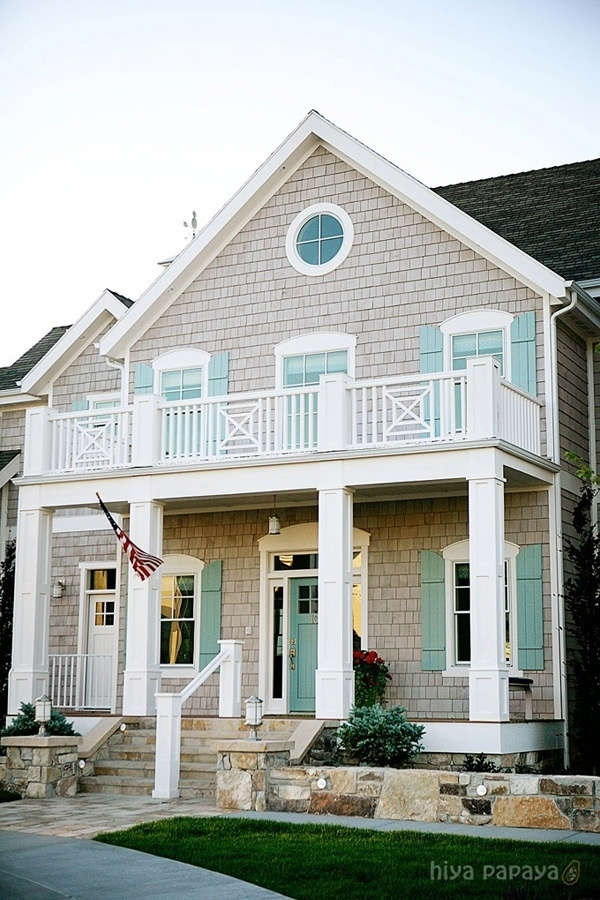 grey house with white trim and aqua shutters and doors