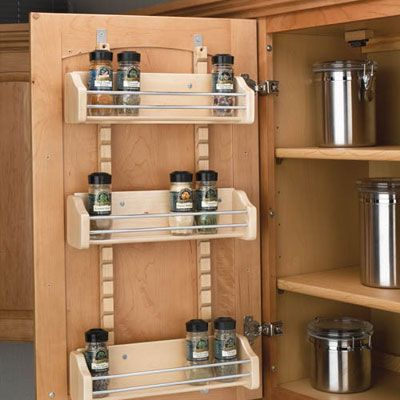 Corral spice jars in a wood rack on the back of a cabinet door near the cooktop. Rev-a-Shelf Adjustable Door Mount Spice Rack, about $60; cabinetparts.com