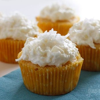 Pineapple and coconut top these light pineapple cupcakes, what a ...