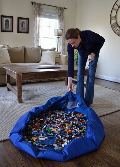 Lego storage/cleanup. Omg, P needs this, I'm always picking up Legos from all over the house!!