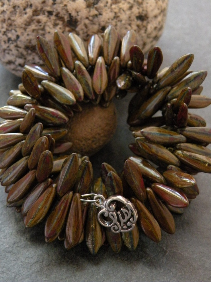 Brown leaf glass memory wire bracelet with a sterling quot sis quot charm