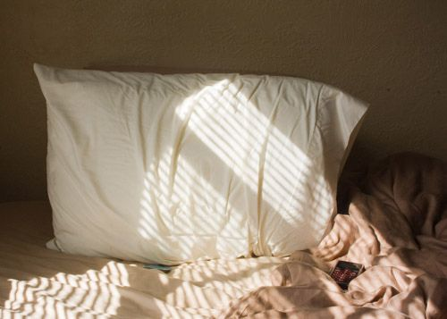 pillow on a unmade bed