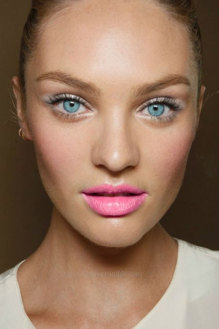 Candice Swanepoel shows how the bright lipstick can be balanced out by adding a light pink blusher to the cheeks so that it isnt so overpowering. Her bright eyes also add to the 'POP'.