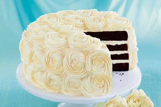 ... like this: white chocolate icing , chocolate icing and white roses