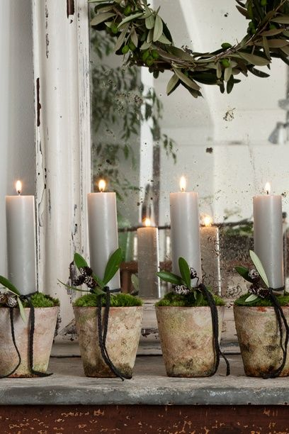 Candles in distressed pots