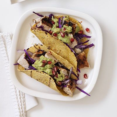 Chicken Pomegranate Guac Tacos    Devin Alexander is the New York Times best-selling author of The Biggest Loser Cookbook series.    Ingredients: Boneless and skinless chicken breast, olive oil spray, salt-free Mexican seasoning, salt, avocado, pomegranate seeds, lime, garlic, corn tortillas, red onion, red cabbage, low-fat queso fresco.