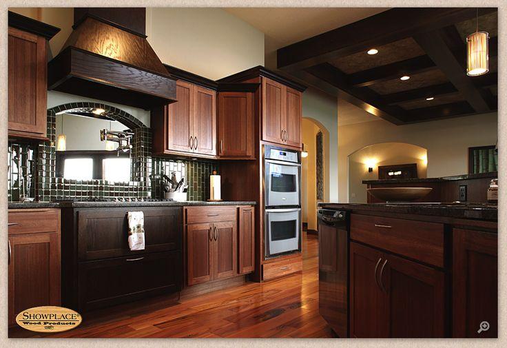Kitchen Lyptus cabinets, medium dark Door style full overlay, handles