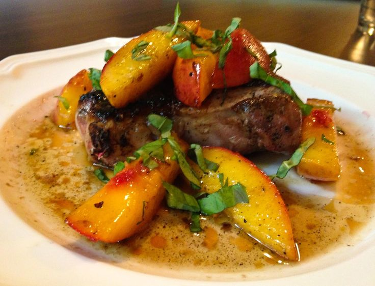 Pork Chops With Peaches, Bourbon, And Basil Recipe — Dishmaps