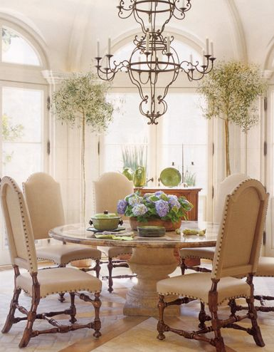Beautiful dining room,thought these were Wall hanging planters in the backdrop , they are actually huge Topiary's in Planters, like this look! Think we can amke this Table out of two Heavy Duty Clay Pots  end to end, then make the table top out of 2x6's with a veneer, love the challenge.